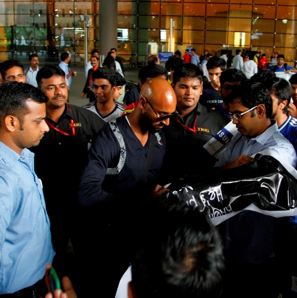 Nicolas Anelka clicks a couple of pictures with his fans and signs some jerseys at the Mumbai airport on his arrival.