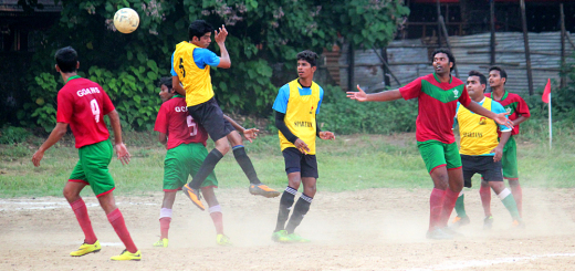Goans Sports Association (Red) and Spartans (Yellow) vie for the ball