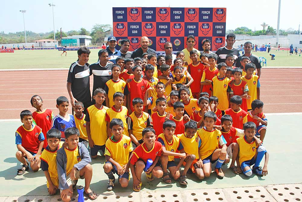 young kids along with Bruno Coutinho and Beto at the FC Goa Grassroots Football Festival