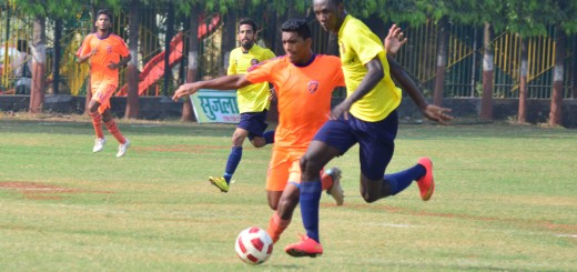 Striker Yao Bernard of Kenkre FC (In Yellow) dribbles opponent PIFA Colaba FC's defender in the quarter final of the 109th Nadkarni Cup 2015