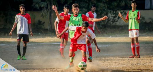 Dadar XI player struggling to keep the ball possesion