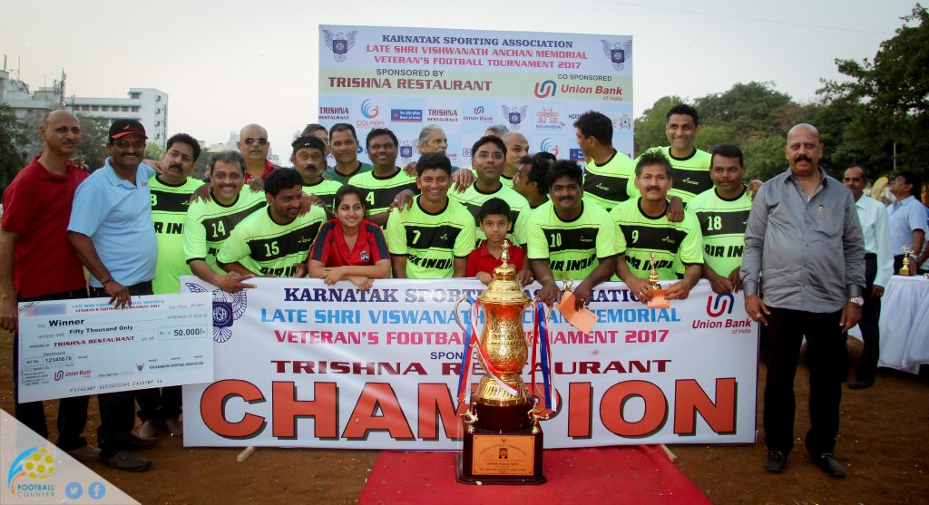 The victorious Maharaja XI players proudly pose with the Champions' trophy along with Chief Guest S.S. Narayan, a two-time Olympic goalkeeper, other dignitaries and KSA Executive Committee members. Maharaja XI defeated Reserve Bank of India 2-0 in the final of the Late Shri Vishwanath Anchan Memorial Veterans' Football Tournament 2017, conducted by the KSA and played at their ground, Cross Maidan.