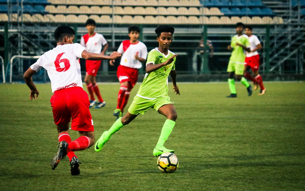 AIFF Youth league: FC Mumbaikar's and Mumbai Warriors player in action at the Cooperage Stadium