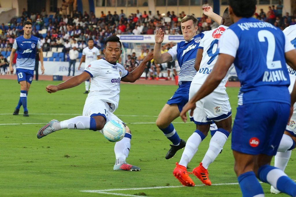 Dhanpal Ganesh's dramatic late winner silenced the Fortress as Chennaiyin FC put it past hosts Bengaluru FC 2-1 in a sixth-round clash of the Hero Indian Super League (ISL). In a match that was billed as a 'Southern Derby' with both coaches making it clear there was added motivation to win this one, Jeje Lalpekhlua provided Chennaiyin FC with the lead in the fifth minute. It stayed that way till the end of the first half but Bengaluru FC, who have scored most of their goals in the second session, got the equaliser in the 85th minute. With five minutes still left to be played, Bengaluru FC fancied their chances of even securing the winner but the much-celebrated match-winner came at the other end as Ganesh headed home in the 88th minute. It was a dramatic end to an invigorating clash that took them to 12 points from six matches, the same as Bengaluru FC and FC Goa, who have a match in hand. Chennaiyin FC, however, are placed third with an inferior goal average. Chennaiyin FC won't mind that, particularly because this victory comes after their loss in Mumbai. John Gregory's side put up a commendable team performance, although it was a great defensive display from players like captain Henrique Sereno, Mailson Alves, Inigo Calderon and Dhanpal Ganesh which helped them hand Bengaluru FC their first defeat at home this season. Chennaiyin FC were also helped by an early goal, scored by their top Indian goal-scorer, Jeje. It came in slightly lucky circumstances as Lenny Rodrigues's clearance deflected off Chhetri and landed right in front of Jeje who did well to slam it past goalkeeper Gurpreet Singh Sandhu. Bengaluru FC coach Albert Roca made six changes to his side as he rested Juanan, Subhasish Bose, Udanta Singh, Erik Paartalu and Braulio Nobrega along with goalkeeper Lalthuammawia Ralte and it showed in their performance as they could not impose themselves on the opposition. Even their highest goalscorer, Miku, who scored in the last four matches, was kept quiet throughout. It was only in the second session that Bengaluru showed more urgency, and with Udanta on the field, chances came thick and fast. Captain Chhetri missed from close range early in the second half but more than made up for that miss with a superb equaliser in the 85th minute. Left unmarked, Chhetri simply picked up a pass from Toni Dovale and gave Chennaiyin goalkeeper Karanjit Singh no chance with his half-volley. Chhetri appeared to have rescued a crucial point and saved Bengaluru's proud home record at the Fortress. However, Dhanpal Ganesh silenced the crowd in the 88th minute when he rose high to meet a scorner from Rene Mihelic.