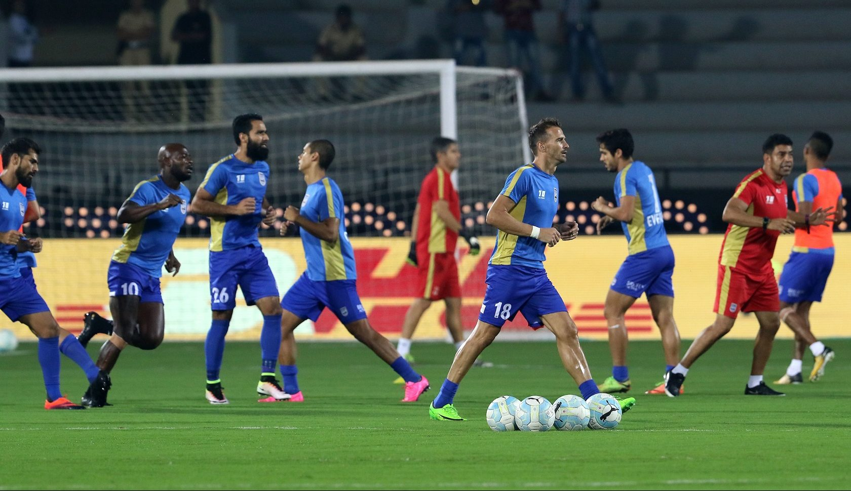 Mumbai City FC players warm up before the start of the match 27 of the Hero Indian Super League Struggling